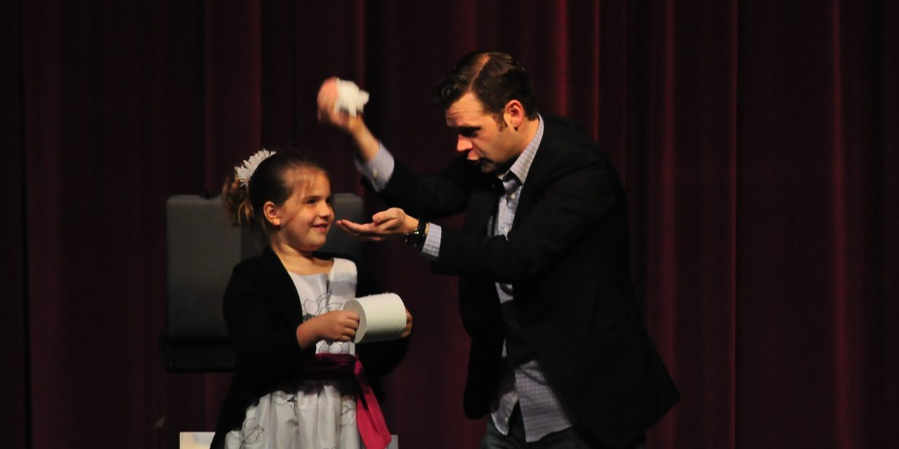 Magician amazes students with illusion, humor