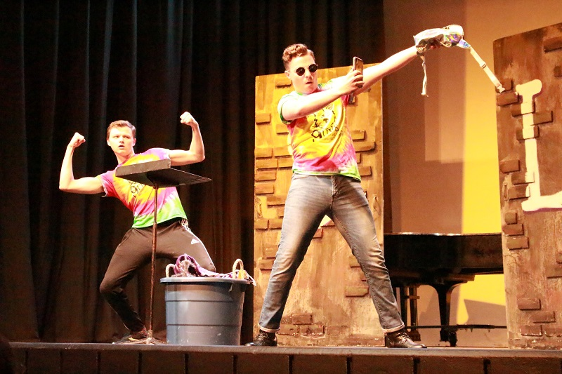 Ryan Pangracs, speech and theatre education sophomore, and Tanner Schartz, musical theatre junior, are performing a skit using items from the audience. Schartz is taking a gym selfie with his new gym bag. Pangracs is photobombing while showing off his muscles. Lauren Sieh/Staff photographer