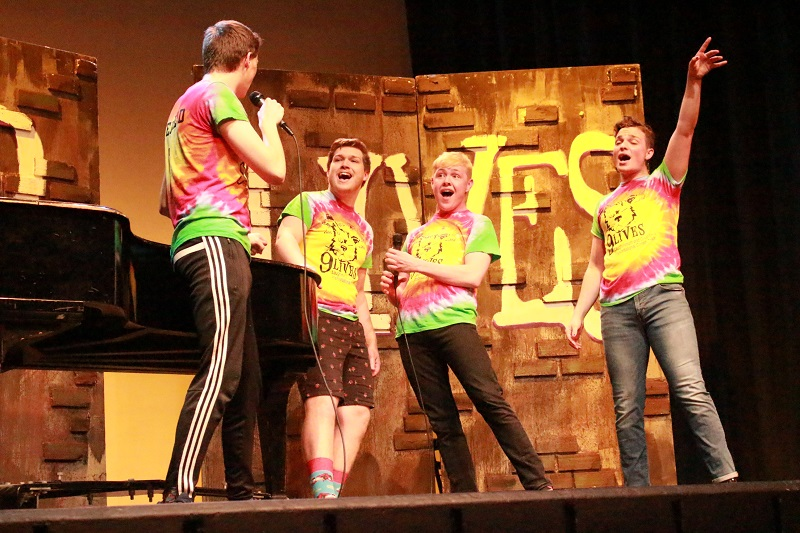 Ryan Pangracs, speech and theatre education sophomore, Jack Warring, musical theatre junior, Samuel Beck, business administration junior, and Tanner Schartz, musical theatre, join together and sing about how their problem are now fixed. Pangracs, Warring, Beck and Schartz hold on to their final note. Lauren Sieh/Staff photographer