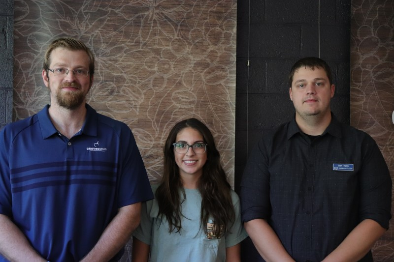 """Josh Tingley, Maggie Patton and Tyler Ratliff, pre health professionals, operate the Graves Drugs flu shots table. Tingley provided some info as to why you should get your flu shots. """"Well, so you don't get the flu, uh, first of all. It also protects your immunocompromised relatives. So like maybe you or I wouldn't be at risk, but if we get it, we can carry it around and maybe it might affect our grandmothers. She's more susceptible, so it's more for them then it is for us at this age."""" The group administered dozens of shots to students during the fair. (Taylor Rodriguez/Staff photographer)"""