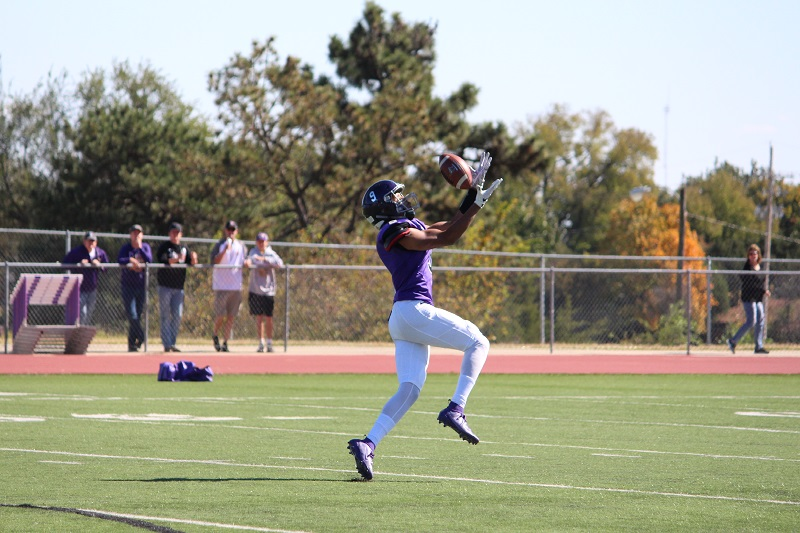 Brooks Shannon, senior wide receiver, catches a long pass during the Oct. 19 game. Shannon led the Builders in receiving yards at 79 yards. (Tessa Castor/Staff photographer)