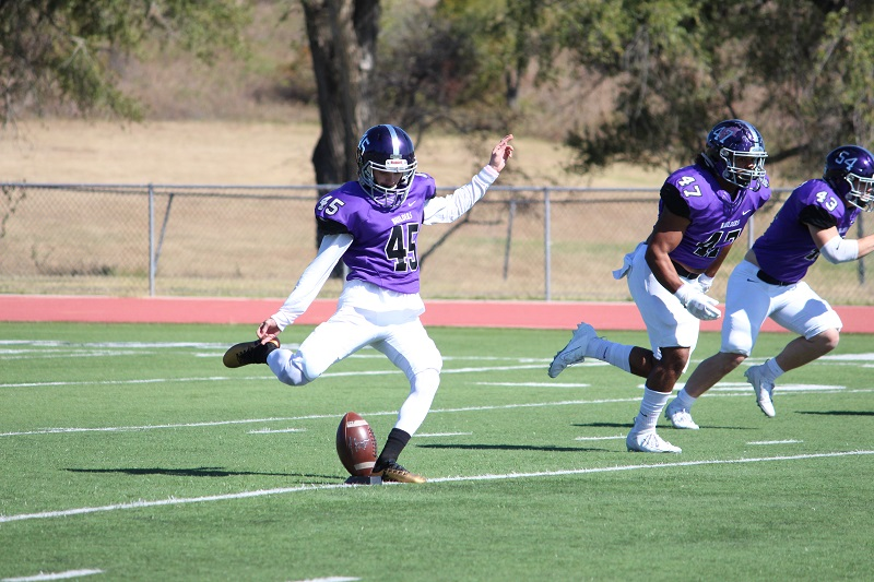 Dalton Rogers, sophomore kicker, kicks off to the KWU Coyotes. The Builders lost 21-45 to Kansas Wesleyan, bringing the Builders an overall record of three wins, four losses. (Tessa Castor/Staff photographer)