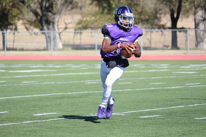 Yizalle Whitfield, freshman quarterback, looks to pass during a Builder offensive run. Whitfield gathered 21 passing yards and 9 rushing yards. (Tessa Castor/Staff photographer)
