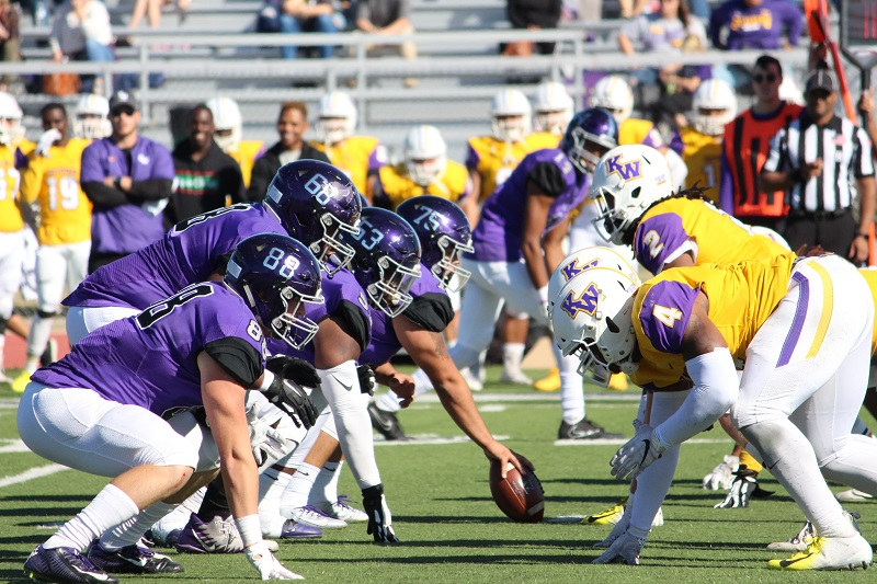 """The Builder offense lines up for an offensive play. """"We win some and we lose some, but we will live to fight another game,"""" said Kenyana Heard, junior offensive lineman. (Tessa Castor/Staff photographer)"""