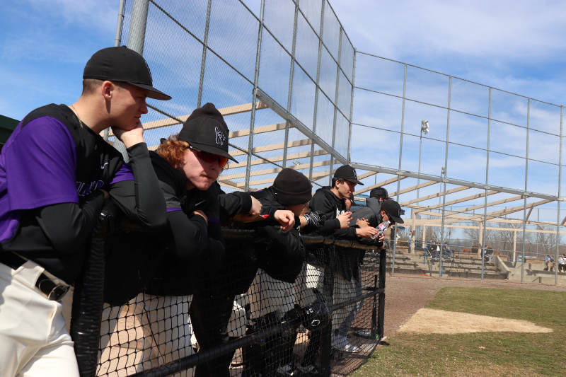 The players in the dugout wait excitedly for their turn at bat. The Builders swiftly defeated Sterling 14-4 by the end of the first match of the doubleheader. (Taylor Rodriguez/Staff photographer)