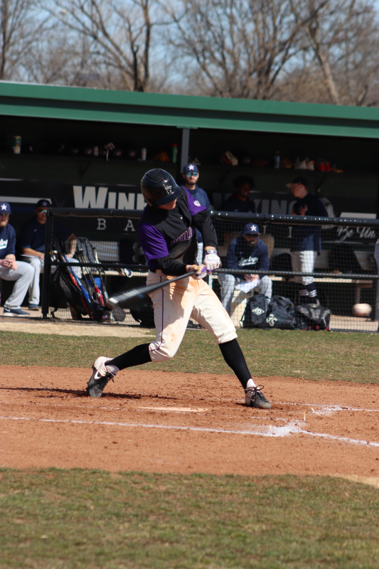 Sterling Spurling, sophomore infielder, takes a crack at the pitch. Spurling led the team with seven hits total by the end of the doubleheader. (Taylor Rodriguez/Staff photographer)