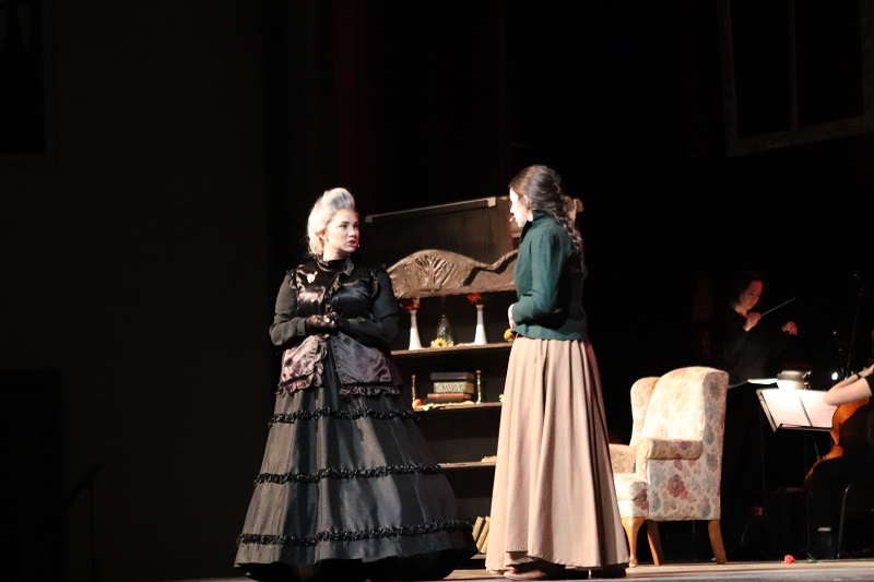 Brynn Hampton musical theatre sophomore and Raynee Case musical theatre sophomore perform a scene form act one of Little Women.  Hampton played Aunt March where she puts pressure on Jo to be a true woman. (Emily Berry/Staff photographer)
