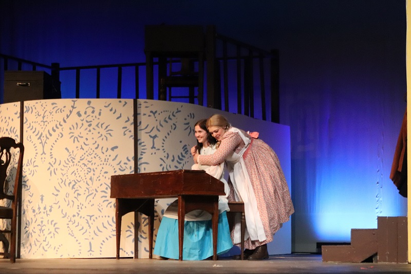 Hannah Breshears musical theatre junior and Maya Damron musical theatre sophomore played the sisters Beth and Amy March in the musical Little Women.  Beth plays the piano and gives advice to her sister Amy. (Emily Berry/Staff photographer)
