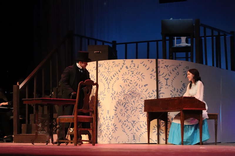 Jacob Montgomery health science junior and Hannah Breshears play a scene with each other.  Montgomery plays the March's neighbor Mr. Laurence and listens to Beth March play the piano. (Emily Berry/Staff photographer)