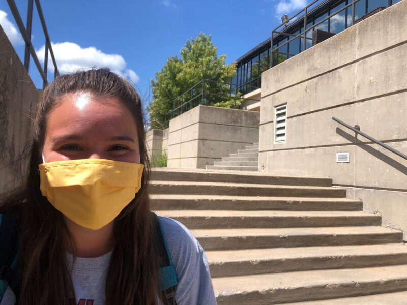 Claire Nichols, senior forward, walks to class. She was sporting a yellow custom facemask.