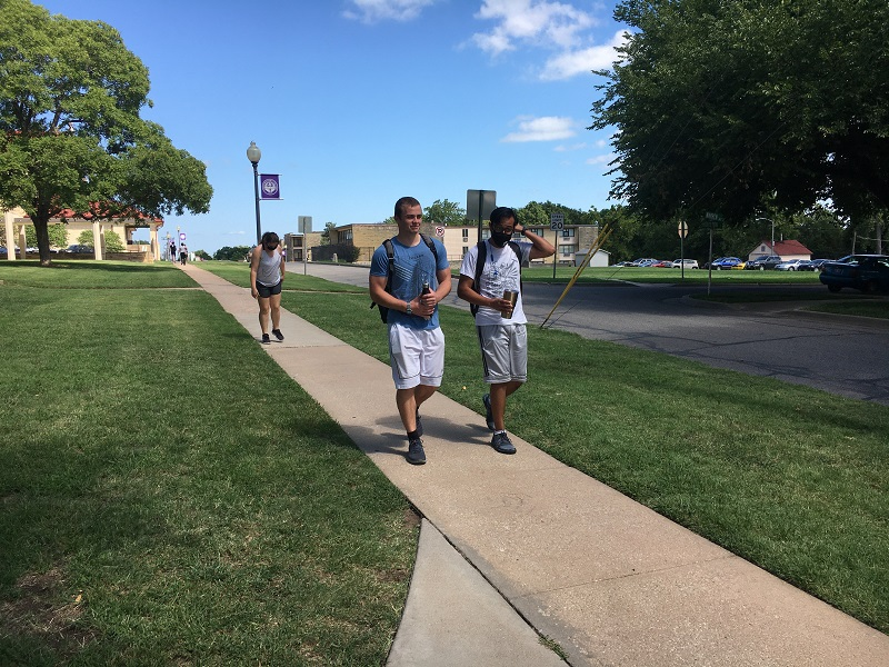 Ryan Andrew, psychology junior, Jesus Flores, psychology junior, and Emily Berry, communication senior, decide to walk to the Winfield Recreation Center. The trio used the walk from campus as their warm up and to campus as their cool down. (Lauren Sieh/Staff photographer)
