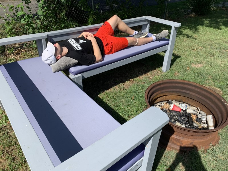 Jake Haertl, business administration senior, naps while taking in the sun. Haertl was resting after weightlifting. (Drake Vittitow/Staff photographer)