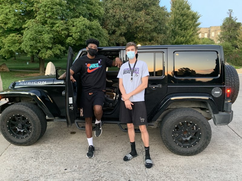 Quintin Wallace, sports science senior, and Geoff Salas, psychology senior, pose with their masks on. Wallace and Salas were taking in the cool air after basketball practice. (Drake Vittitow/Staff photographer)