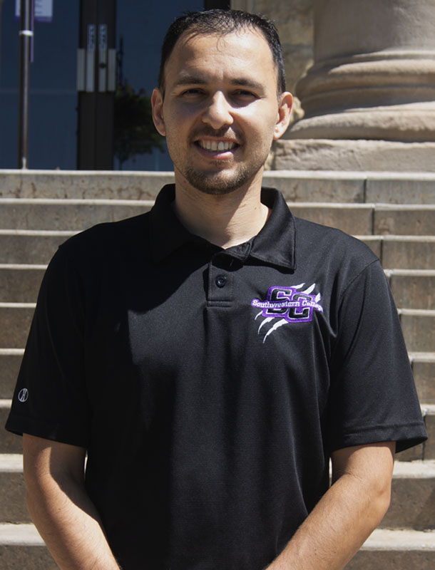 """Tim Alaniz a Vernon, TX native is the assistant volleyball coach. He attended Midwestern State University and graduated with an associate's and bachelor's degree in radiology. Alaniz has seven years of colligate coaching experience. He got his start at Newman University in Wichita, where he held a position on the schools coaching staff for two consecutive seasons. He then decided to return to his alma mater Midwestern State and coach for four seasons. Through hard work and diligence, he worked his way up to the Division I level, where he held the technical coordinator position for one season. A quote that he lives by is """"Coaches don't care how much you know until they know how much you care."""" (Derrick Culpepper/Staff reporter) (Daegiona Wilson/Staff photographer)"""