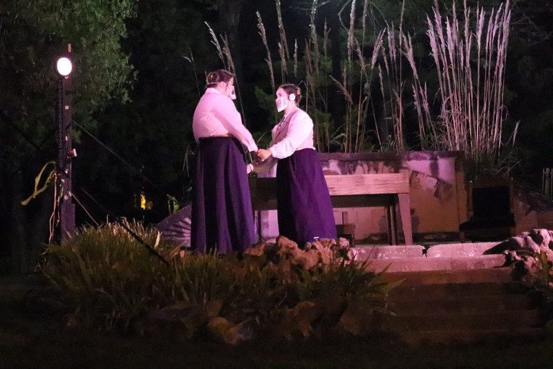 Margaret Leavitt, played by Telara Day, musical theatre senior, and Henrietta Leavitt, played by Elizabeth Santana, theater performance junior, share a sisterly moment. The sisters were reunited after many years apart. (Lauren Sieh/Staff photographer)