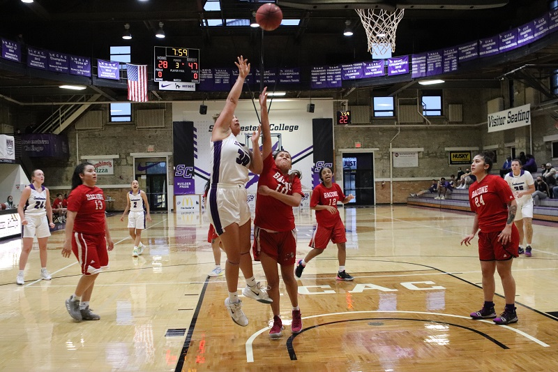 Ashley Carrillo, senior forward, reaches for a layup. Carrillo had a total of 14 rebounds, the most of the team. (Lauren Sieh/Staff photographer)