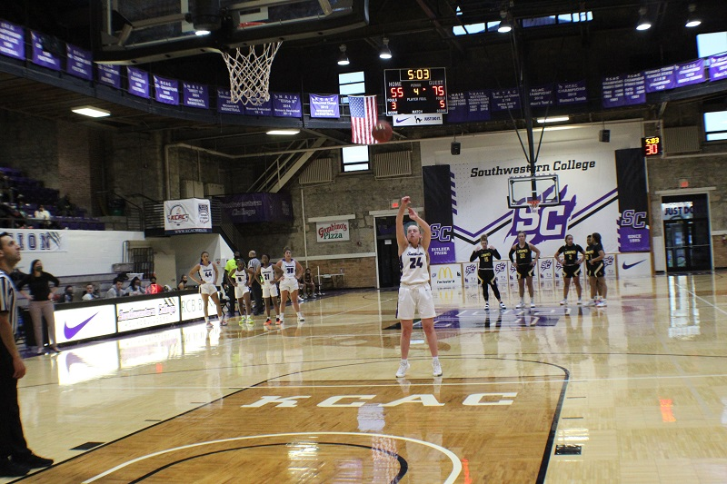 Ashton Burdick, senior guard, shoots a solo free throw. The pack of Dovers and fellow Moundbuilders are pushed back to half court for the solo shot. (Lex Gouyton/Staff photographer)