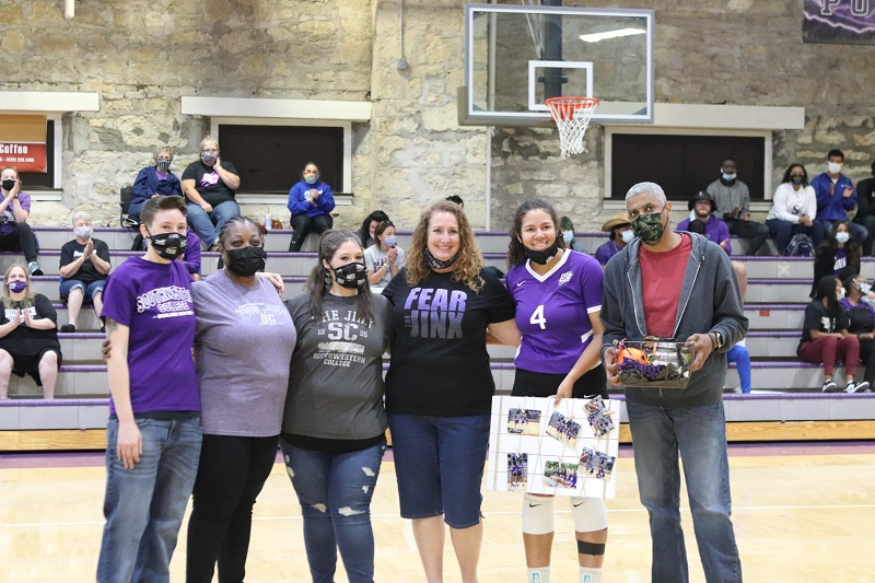 Lezlee Dixon, senior middle hitter, poses with her family. Dixon had seven total attempts and three kills during the game. (Lauren Sieh/Staff photographer)