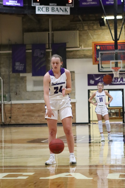 Ashton Burdick, senior guard, steps up to the free throw line. Burdick scored a total of 18 points during the game. (Lauren Sieh/Staff photographer)
