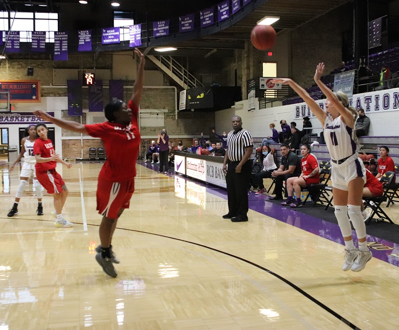 Amanda Graddy, freshman guard, shots for a three. Graddy scored seven points and had the second most playing time with 34 minutes. (Lauren Sieh/Staff photographer)