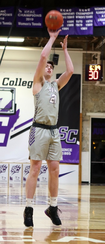 Anthony Hickman, junior forward, shoots a free throw. Hickman scored one point and had one rebound during the game. (Lauren Sieh/Staff photographer)