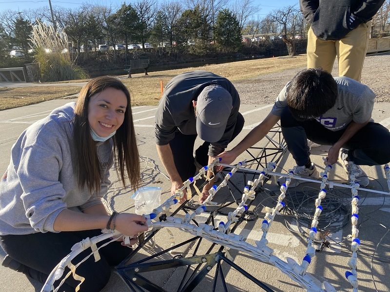 Morgan Graves, biology junior poses as she helps set up for the Isle of Lights in Island Park. She worked together with the track and cross country team. (Mallory Graves/Staff photographer)