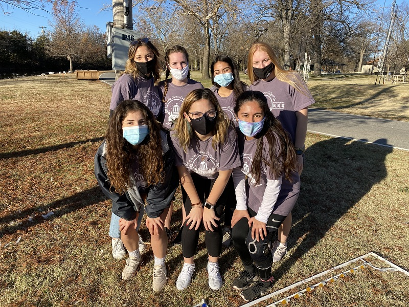 Members of the women's soccer team participated in the Isle of Lights set up. They spent their time volunteering to help out the Winfield community. (Mallory Graves/Staff photographer)