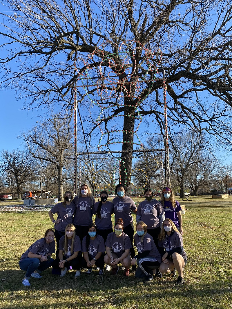 The softball team worked hard to put up the big jack in the box light. They also put up the mini display of blocks, drums and angels and the stocking light structures. (Mallory Graves/Staff photographer)