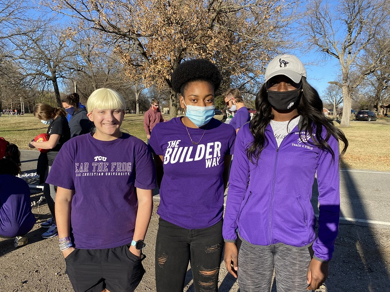 Anna-Lise Kirton, biology freshman, Terri Jeffery, education freshman and Adrien Jones, sports management senior are members of the track and cross country teams. They built the Arch of Doves. (Mallory Graves/Staff photographer)