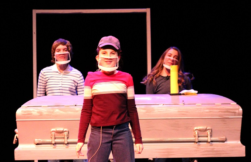 """Christian Bechdel, played by Savannah Joldersma, marine biology senior, John Bechdel played by Mary Tyler, Whittier elementary student, and Small Alison, played by Kathleen Miller, piano performance sophomore, sing """"Welcome to the Fun Home."""" The song is for a commercial for the Fun Home. (Lauren Sieh/Staff photographer)"""