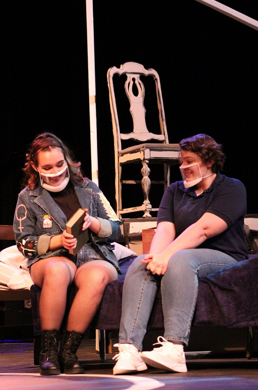 Joan, played by Elizabeth Santana, theatre performance junior, and Medium Alison, played by Maya Damron, musical theatre junior, sit on the bed while looking at a book. The book serves as a pivotal moment the Medium Alison realization of her sexuality. (Lauren Sieh/Staff photographer)