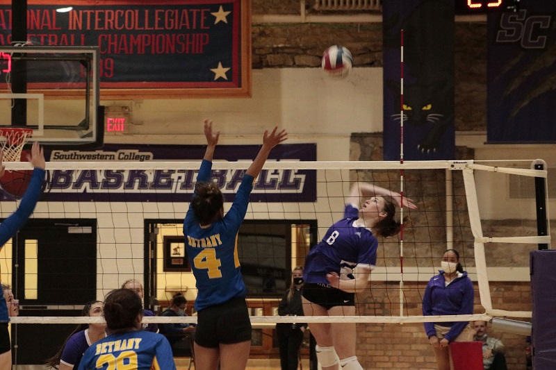 Cierra Harrison, freshman outside hitter, gets ready to finish a kill. She had five kills on the night with to match with five digs. (RJay McCoy/Staff photographer)