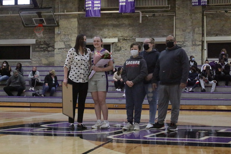 Ashton Burdick, senior guard, is recognized on senior night. She is accompanied by her family. (Mallory Graves/ Staff photographer)