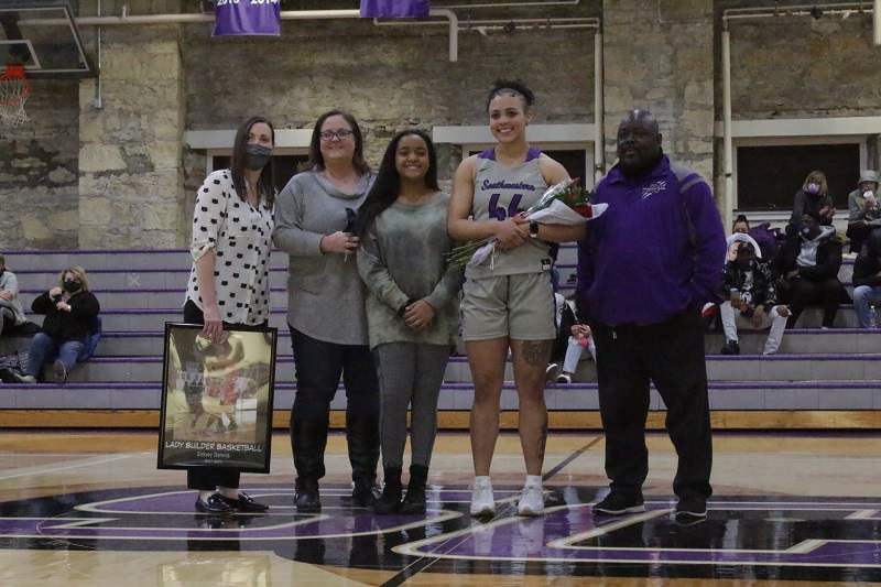 Sidney Dennis, senior forward, celebrates senior night with her family. (Mallory Graves/ Staff photographer)