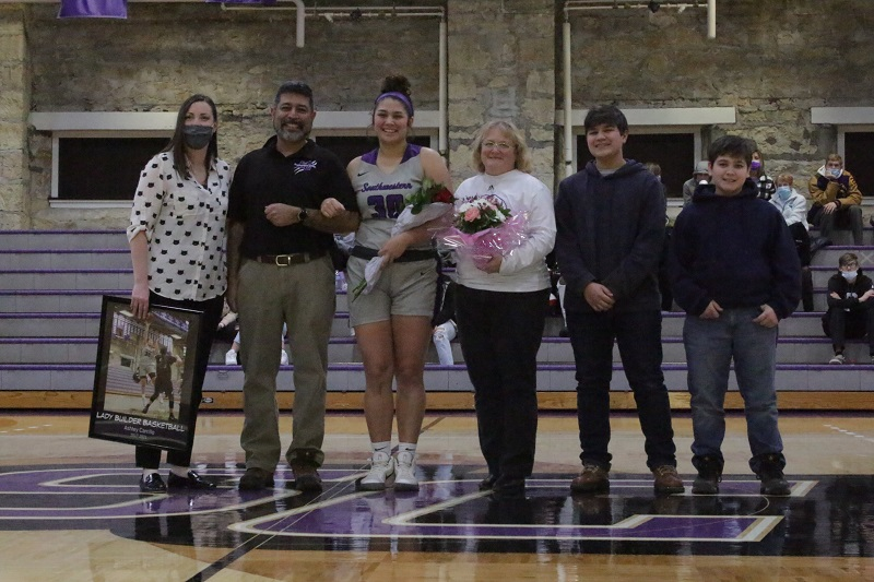 Ashley Carrillo, senior forward, and her family pose for a picture. The night was a bittersweet for her, for it concluded her time as a student athlete. (Mallory Graves/Staff photographer)