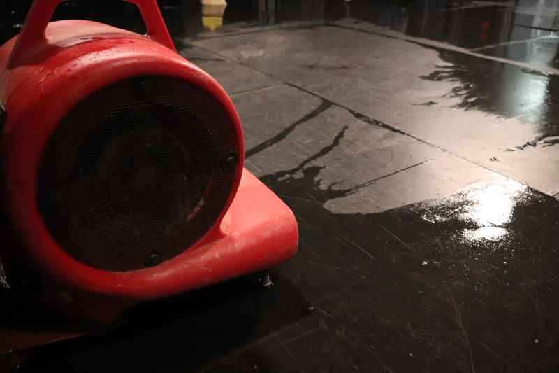 A fan helps with the water removal process. The floor was installed around five to six years ago according to Jacob Reynolds, technical theatre junior, and will most likely need to be replaced in the coming months for fear of mold. (Taylor Rodriguez/Staff photographer)