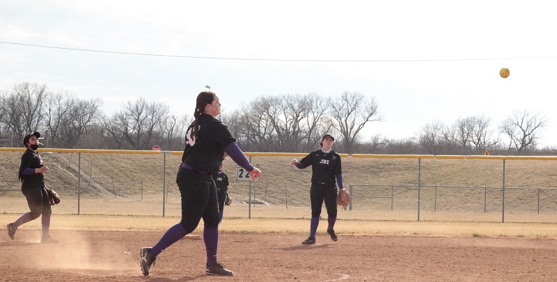 Kalley Henson, junior pitcher, makes routine play over to first after comeback groundball.  (RJay McCoy/Staff photographer)