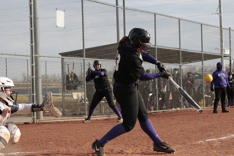 Alexis Guyton, senior infielder, takes a hack at the incoming pitch. Guyton went two for eleven on the day with a double, run batted in, and two bases on balls. (RJay McCoy/Staff photographer)