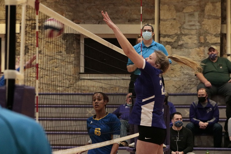 Elizabeth Borgelt, freshman middle hitter, goes up to block an opponent attack. She had four solo blocks on the night. (RJay McCoy/Staff photographer)