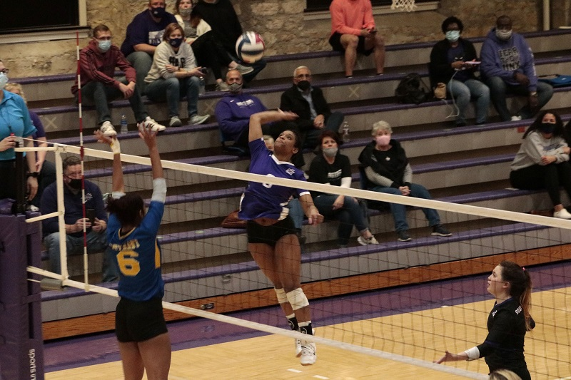 D'Sani Levy, freshman middle hitter, attempts at a kill. She had a combined 20 kills on the night. (RJay McCoy/Staff photographer)