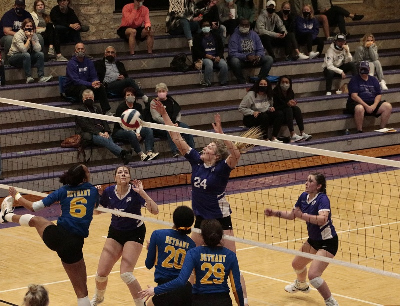 Elizabeth Borgelt, freshman middle hitter, denies Swedes defenders attacking. She had one block with two block assists against Bethany. (RJay McCoy/Staff photographer)