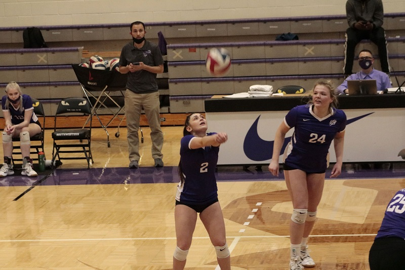 Mia Hehmke, junior defensive specialist, gets ready to set a teammate up for a kill. She racked up 13 digs between the two games. (RJay McCoy/Staff photographer)