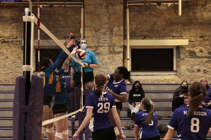 Sydney Morris, freshman outside hitter, finishes a kill attempt. She had 27 solo kills in two games. (RJay McCoy/Staff photographer)