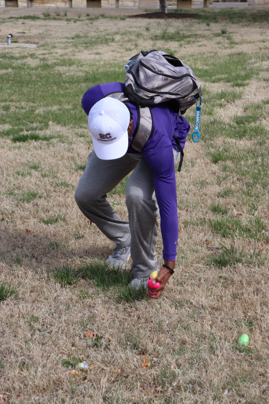 Brandon Jessie, math freshman, scoops up his third egg. Jessie did not pick up an egg with cash unfortunately. (Taylor Rodriguez/Staff photographer)