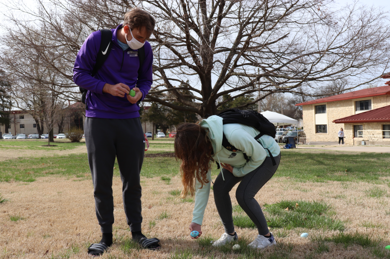 Noah Murphy, psychology sophomore, and Jayda Green, physical education sophomore, decide which eggs to snag. Green helped Murphy pick his eggs since she didn't have her FAFSA filled. (Taylor Rodriguez/Staff photographer)