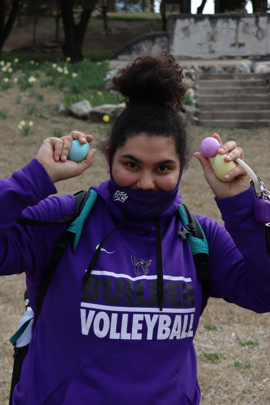 MiCaila Holland, business administration and accounting junior, proudly displays her choices. Holland did not win any of the cash prizes after opening her eggs.(Taylor Rodriguez/Staff photographer)