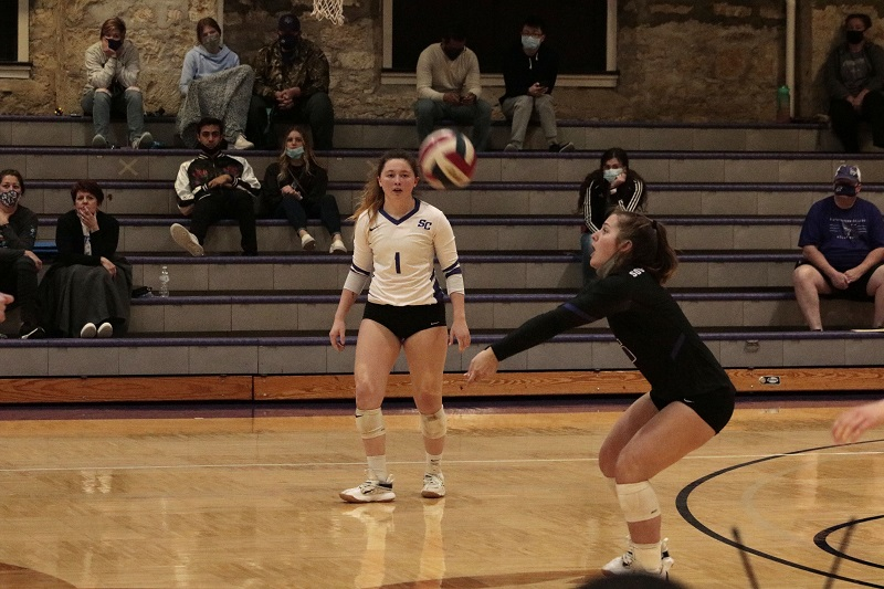 Sierra Norlin, freshman defensive specialist and setter, receives the serve from the Bulldogs. (RJay McCoy/Staff photographer)