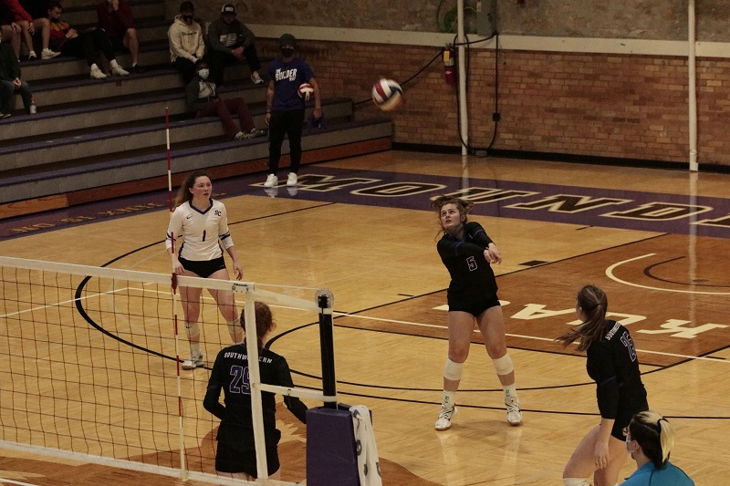 Sierra Norlin, freshman defensive specialist and setter, returns received serve from the Bulldogs. (RJay McCoy/Staff photographer)