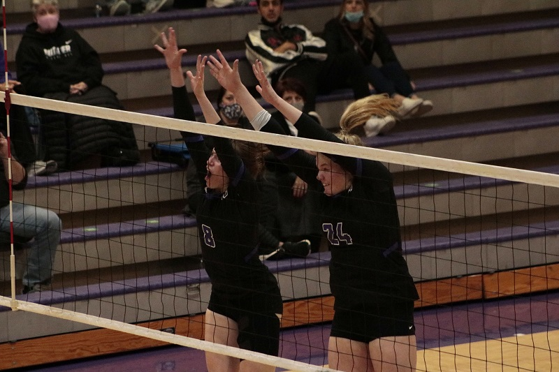(left to right) Cierra Harrison, freshman outside hitter, and Elizabeth Borgelt, freshman middle hitter, go to block an opponent kill attempt. The team had seven solo blocks on the night. (RJay McCoy/Staff photographer)