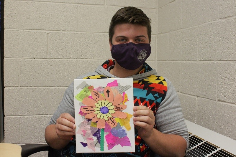 Brandon Murphy, philosophy and religion sophomore poses with his painting. He was relieved after taking part in this fun activity. (Mallory Graves/Staff photographer)